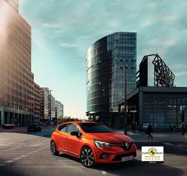 Clio coche pequeño exterior naranja